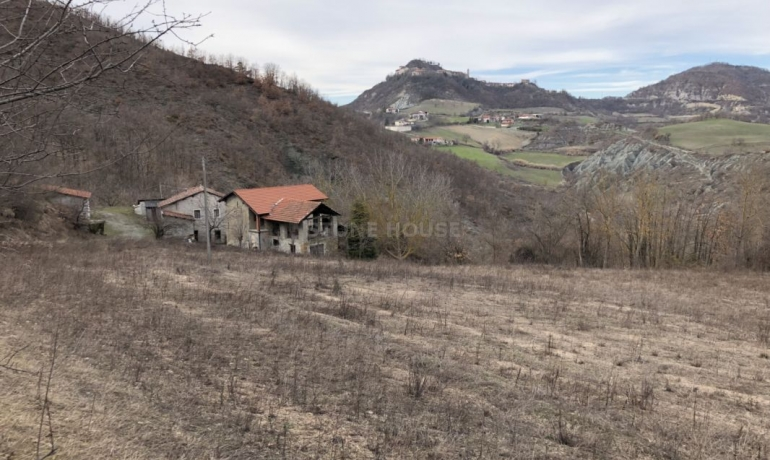 Old stone house with land and panoramic view